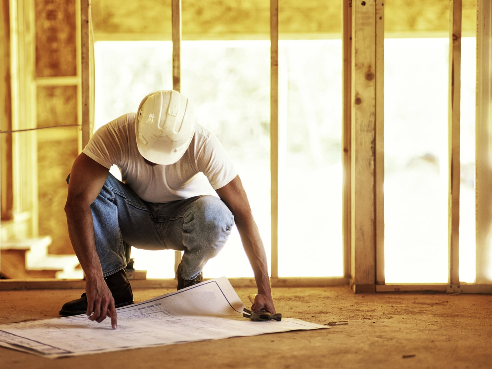 Construction Worker Viewing Blueprints Stock Photo