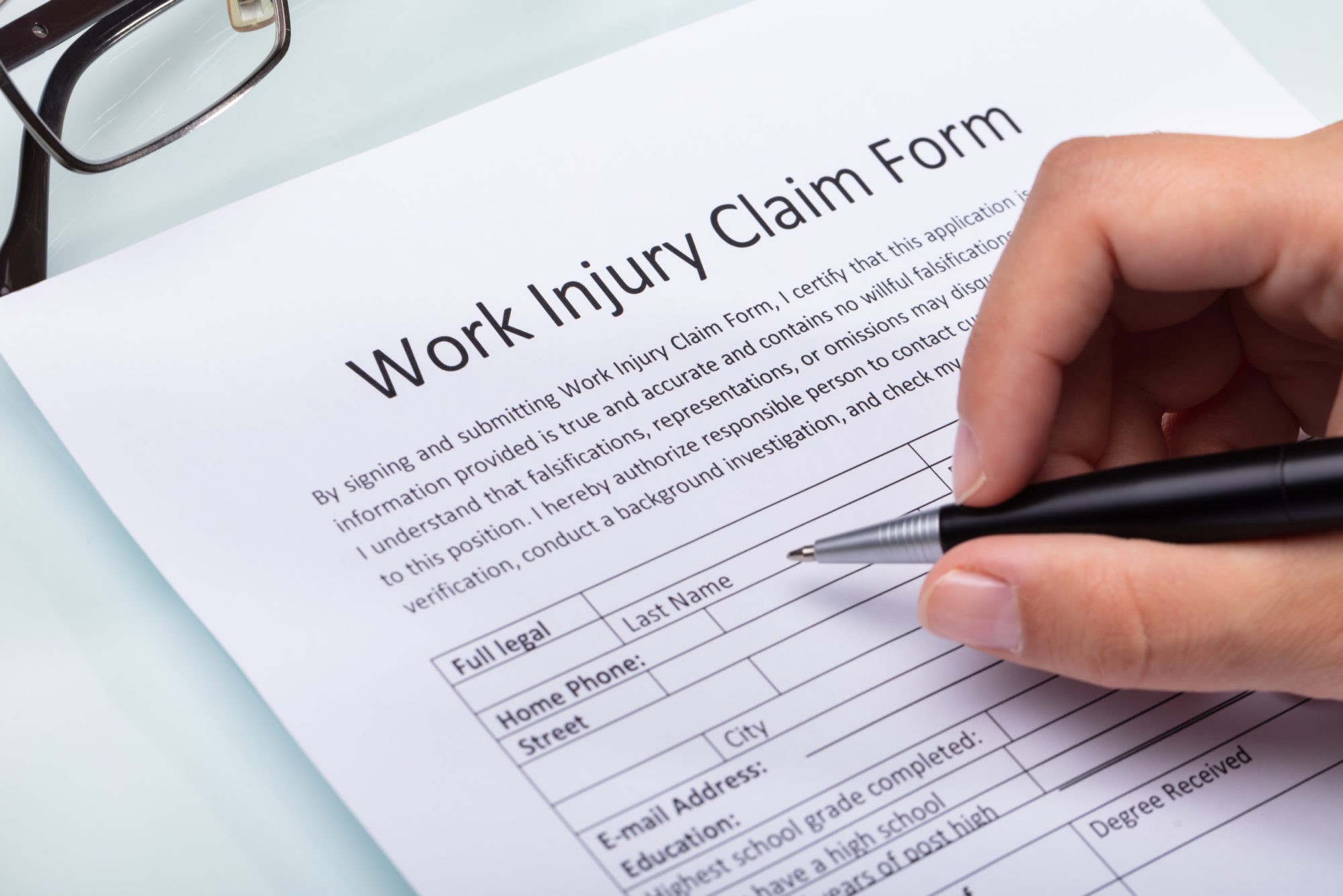 worker filling out a workers' compensation claim form
