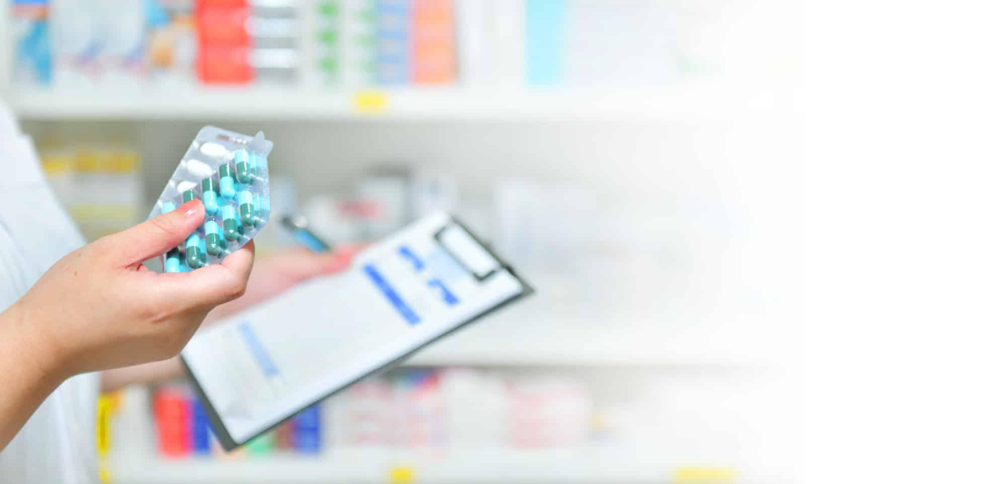 pharmacist filling a medication order