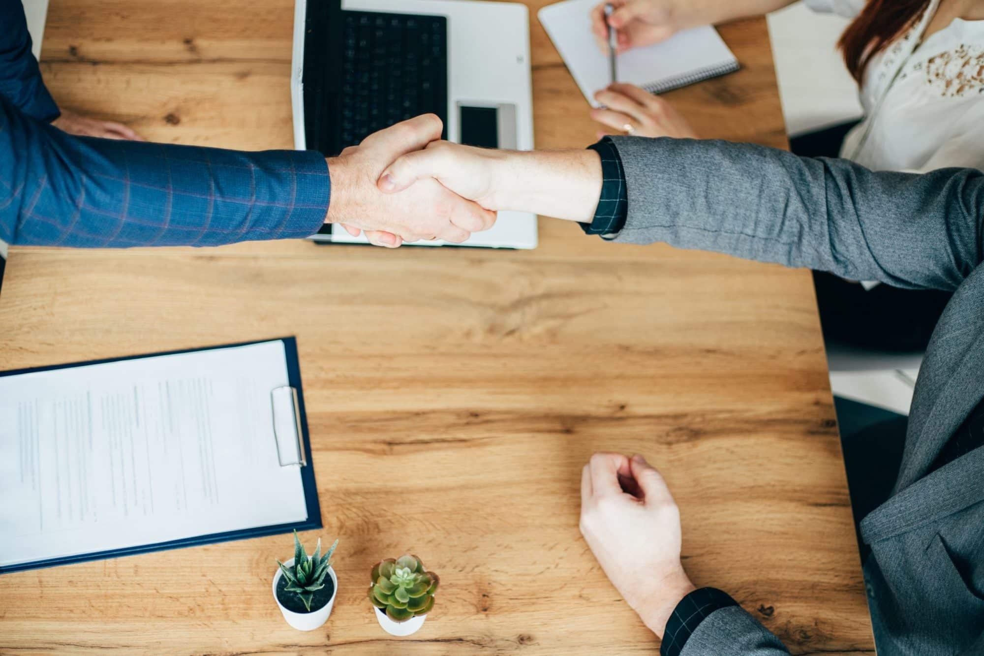 Business partners handshaking after deal