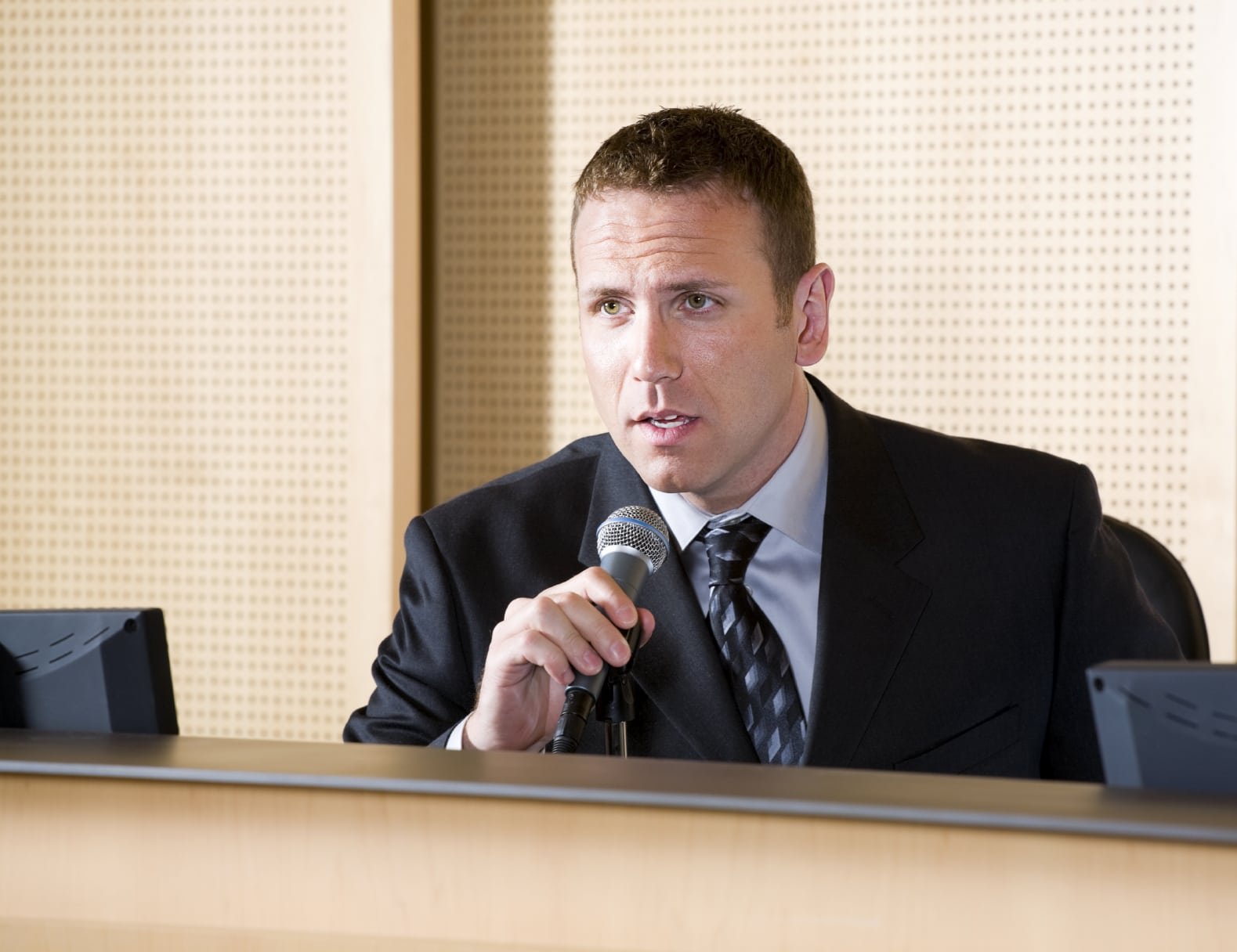 Young Man Giving Testimony In Courtroom Stock Photo