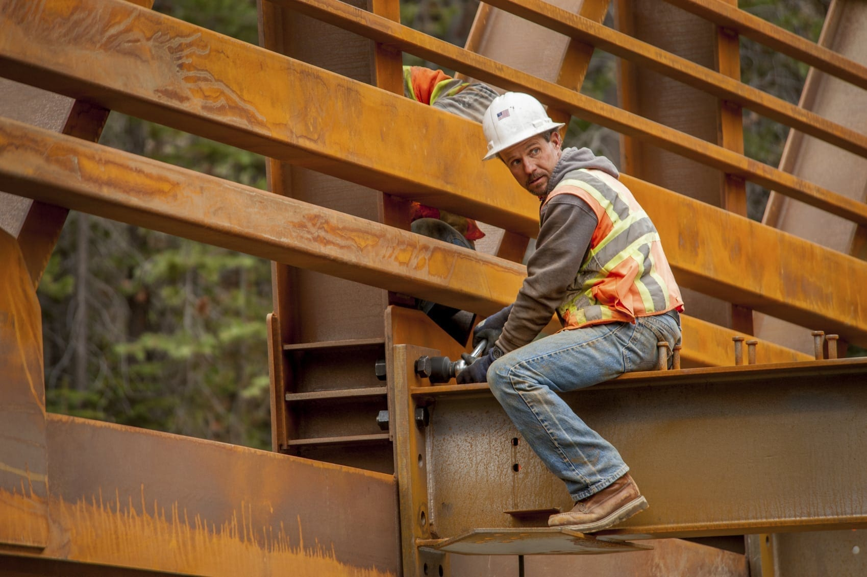 Construction Worker On A Beam Stock Photo