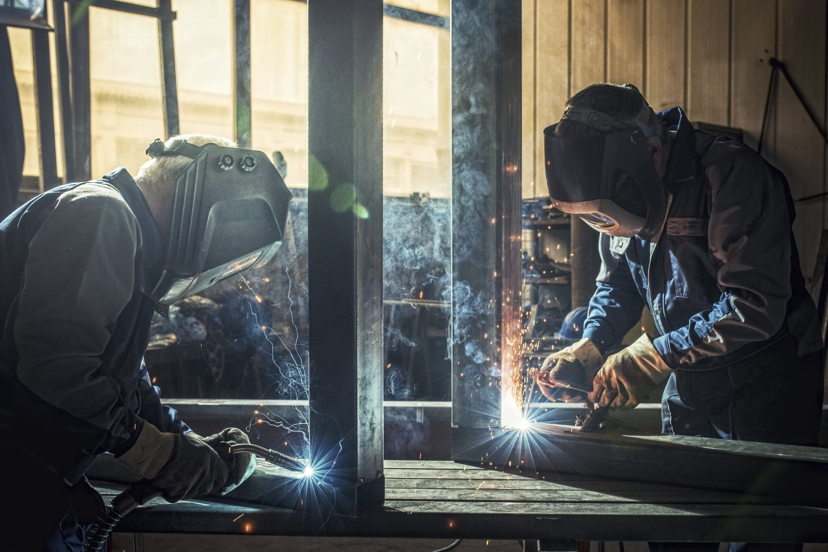 Welders Working On Metal Stock Photo