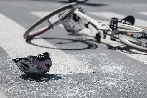 Bicycle laying in street after accident