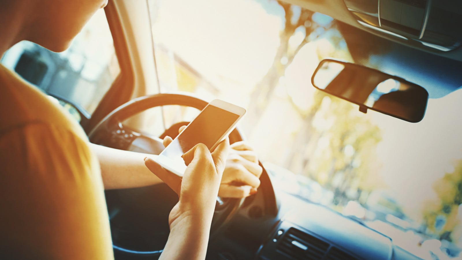Texting and Driving Stock Photo