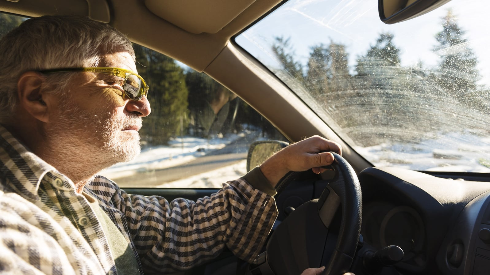 Elderly Man Driving Vehicle Stock Photo