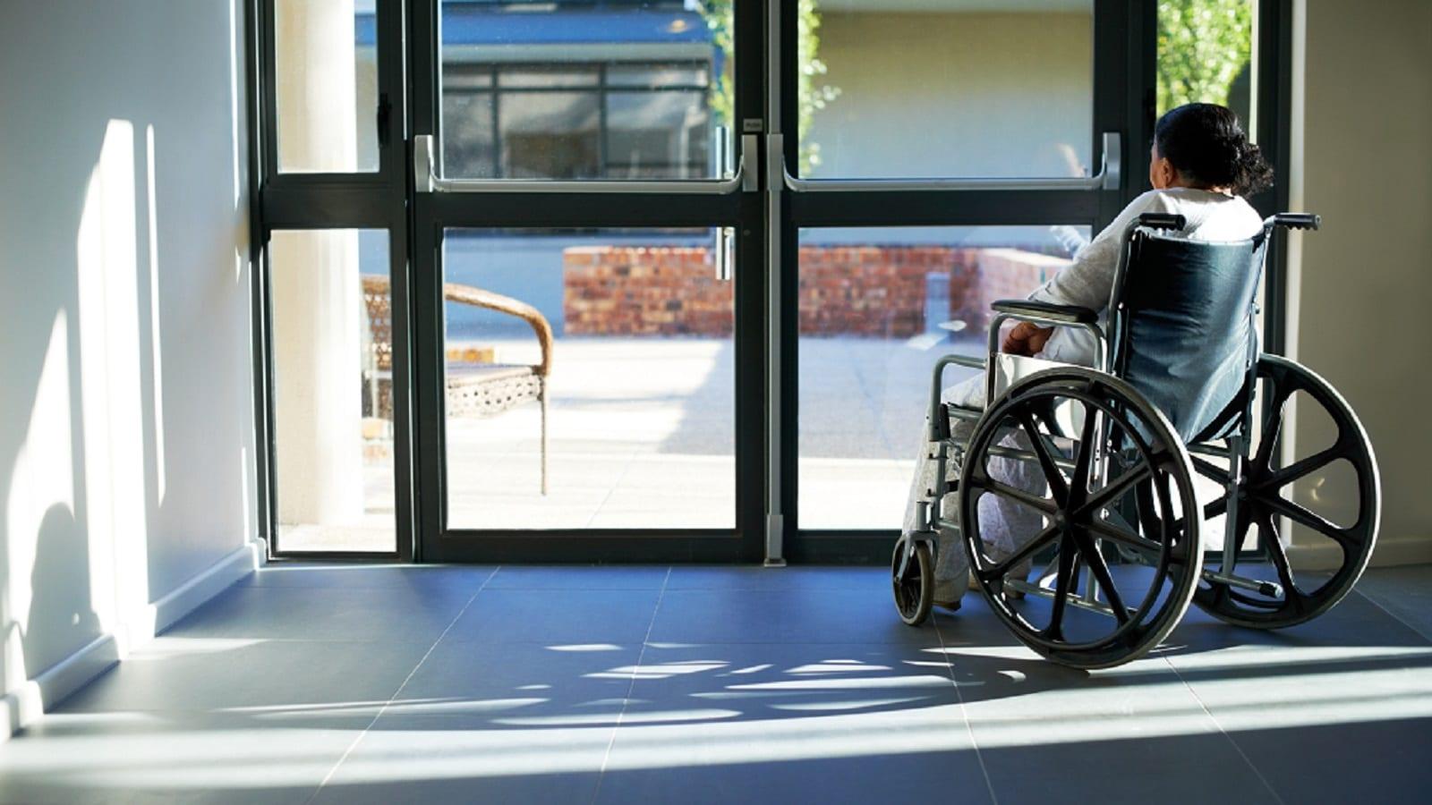 Elderly Woman In A Wheelchair Stock Photo