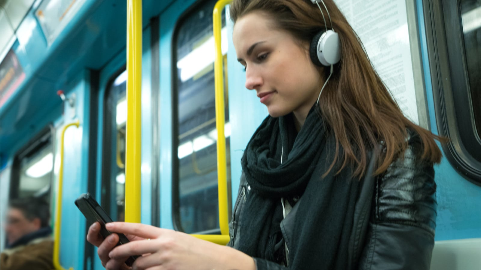 Woman Listening To Music On Subway Train