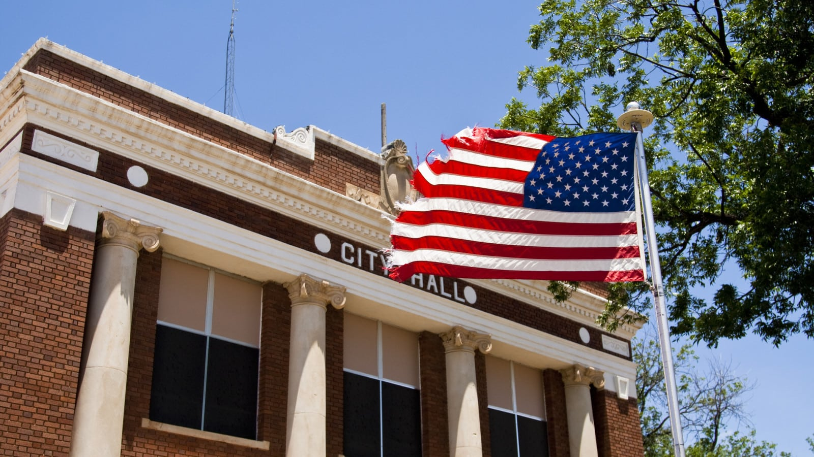 City Hall And American Flag Stock Photo