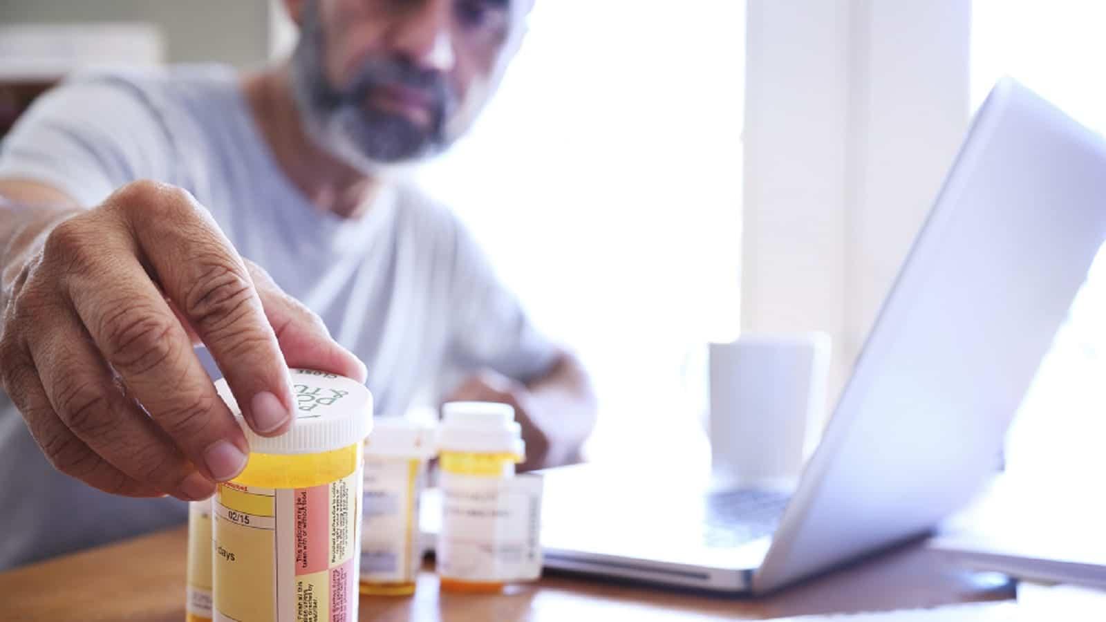 Man Reaching For Prescription Medication Stock Photo