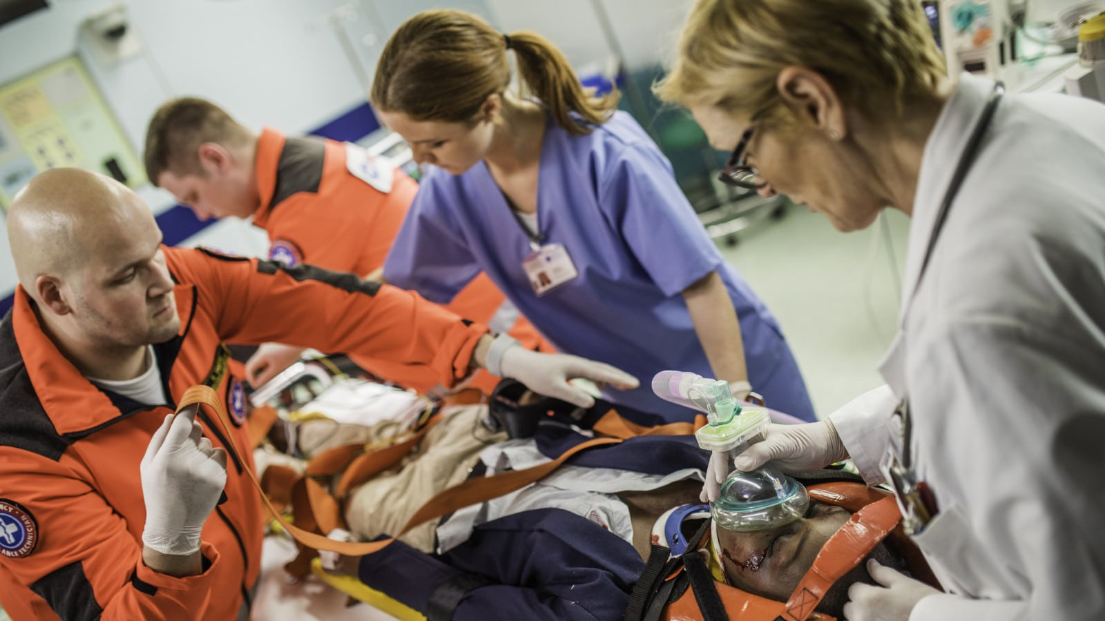 Paramedics Treating Patient Stock Photo
