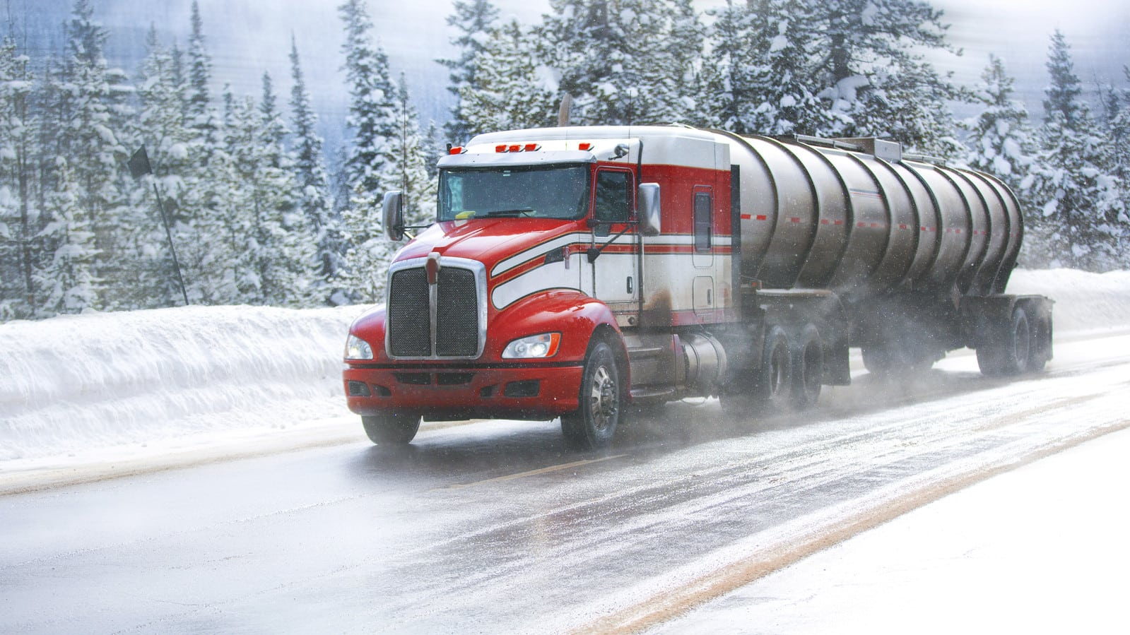 18-wheeler Truck Driving In The Snow
