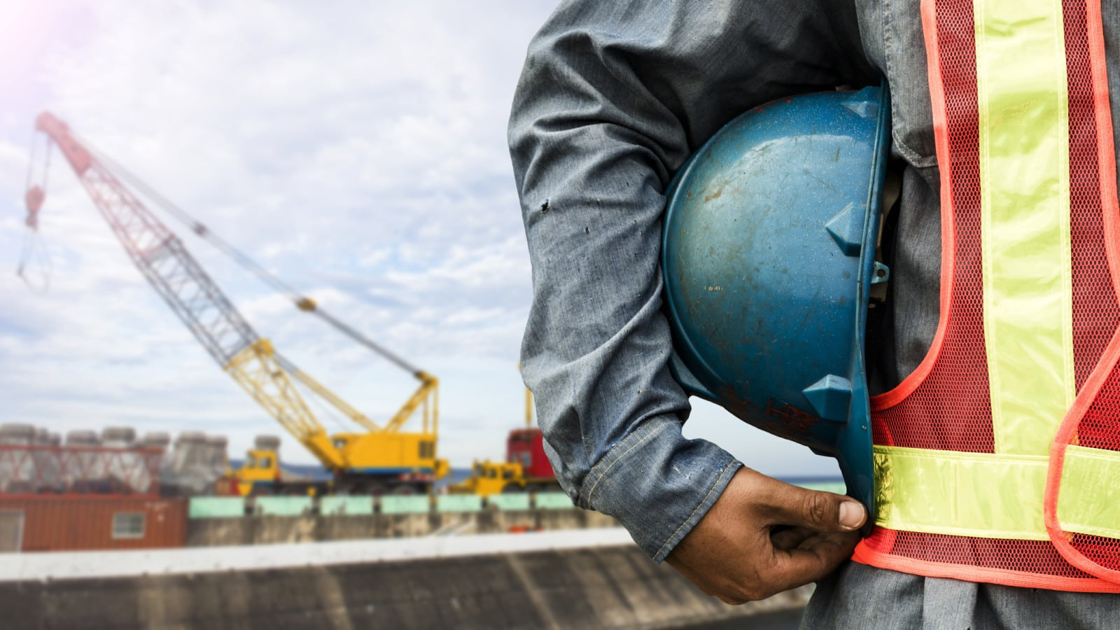 Construction Worker With Crane Stock Photo