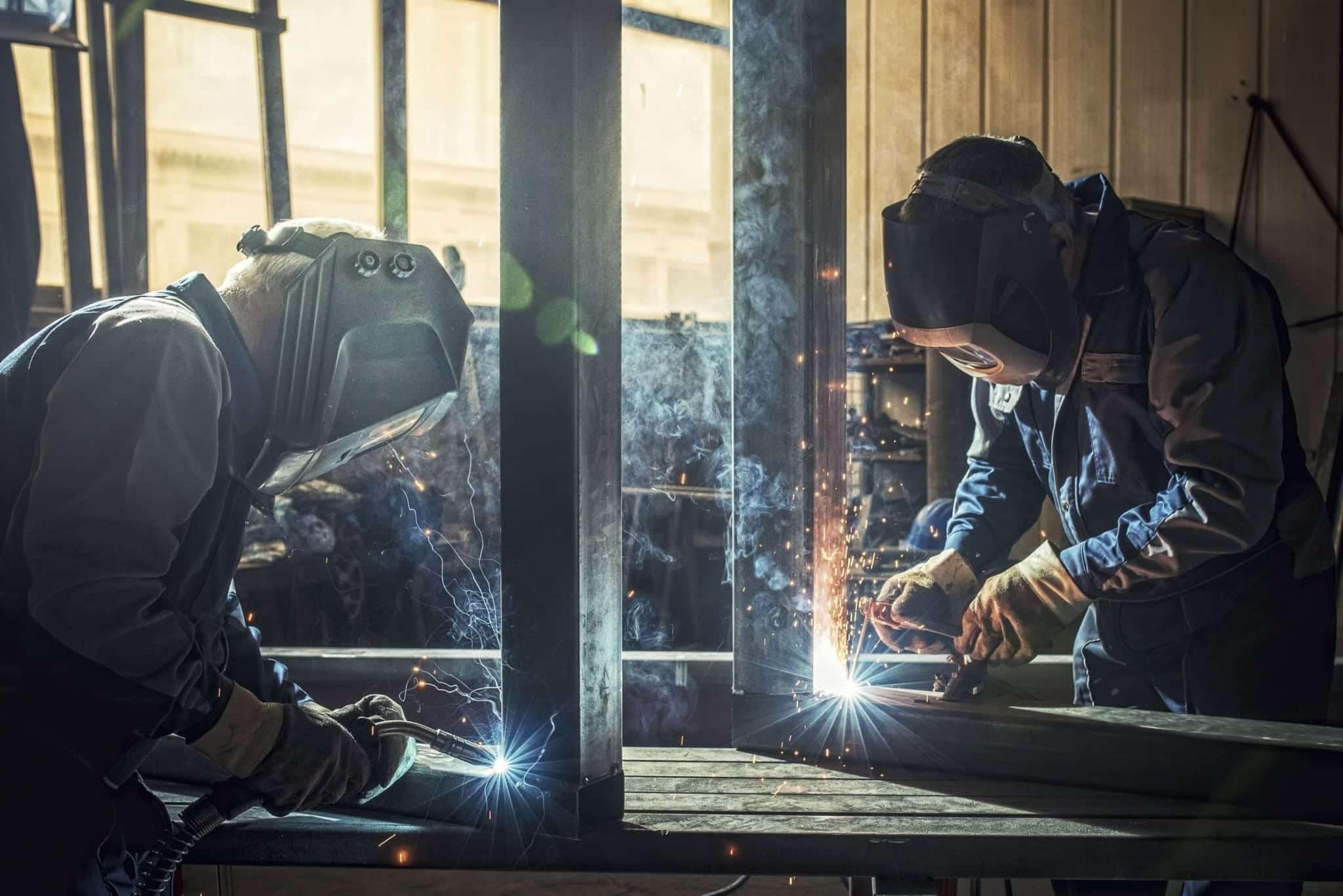 Welders Working On Metal Stock Photo