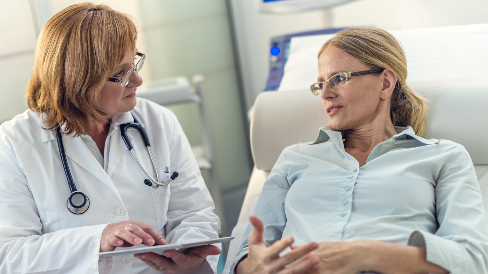 Female Doctor Meeting With Female Patient Stock Photo